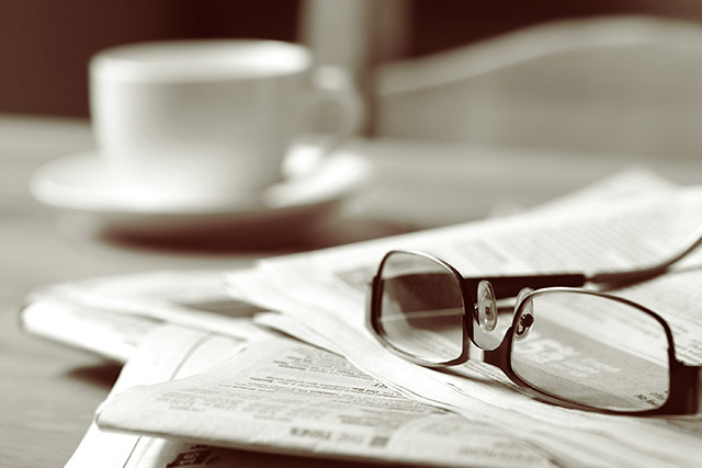 bigstock-Newspapers-and-coffee-cup-wit-14356142